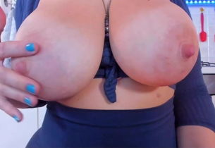 Yam-sized jugs breasts on cam with nip..