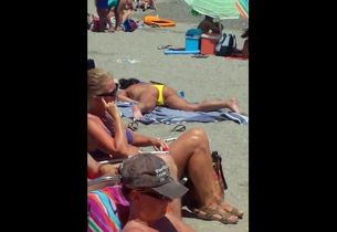 Eyed a damsel milking on a public beach